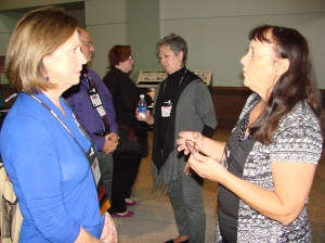 Dorothy Nelson talks with alum Lisa Wilson, University of Southern Indiana. Ann Knackendoffel in the background.
